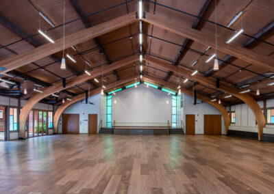 5,700 sq.ft. Auditorium; view from the main entrance toward the stage. Photo credit Alan Alabastro.