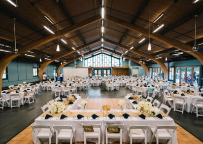 Auditorium set up with tables for a wedding reception.