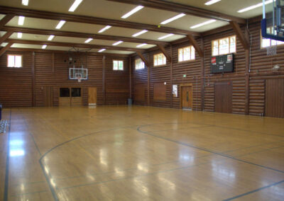 The enormous 4,500 sq. ft. gym has a 19 ft. x 16 ft. stage and floor-to-ceiling stone fireplace.