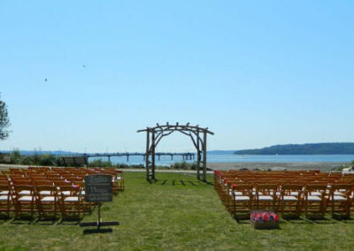 Soon, fresh flowers will decorate these chairs and arch, guests will arrive, and love will blossom.
