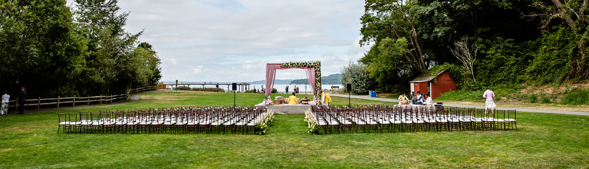 Meadow Waterfront Wedding Ceremony - Chairs Arch - Des Moines - James Thomas Long Photography
