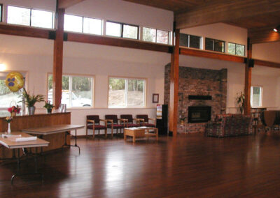 The Activity Center features a large stone fireplace and rows of windows for plenty of natural light.
