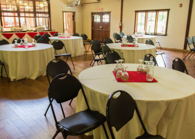 The Dining Hall's main room with reception tables set for a meeting.