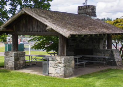 The historic Field House Picnic Shelter with four picnic tables.