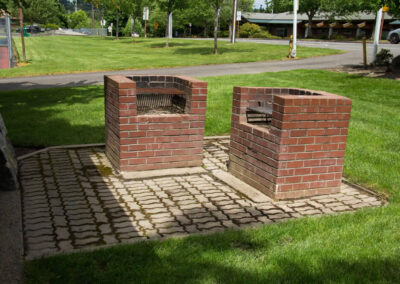 Built-in brick BBQ grills next to the Field House Picnic Shelter.