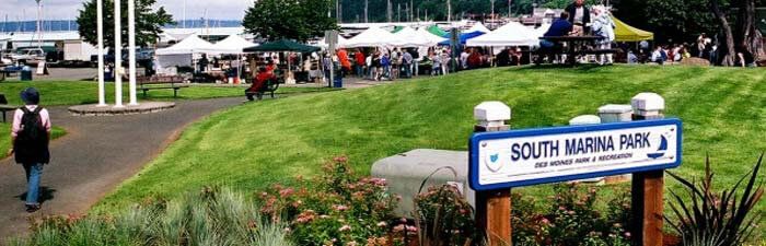 A bustling outdoor event at the Des Moines Marina's South Marina Park.