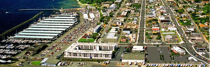 Des Moines Marina at the left, adjacent marina parking lots, and Marina District (center) with boutique shopping and popular seafood restaurants.